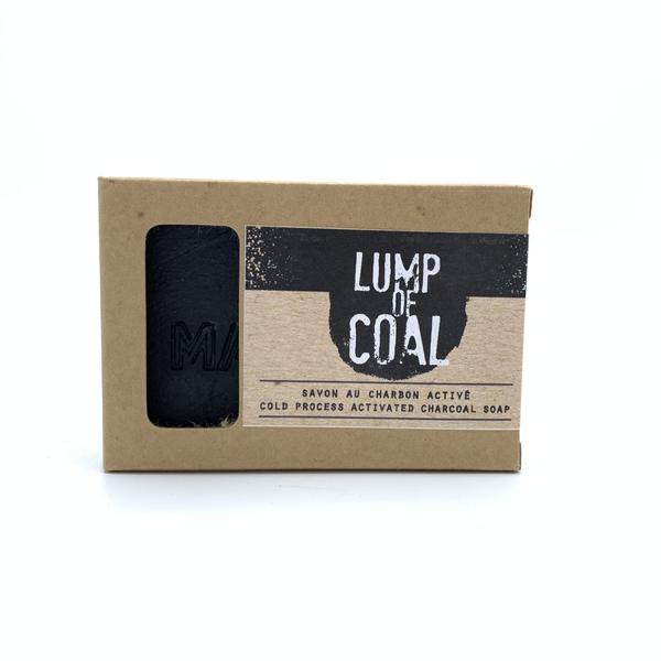 A lump of goal joke Christmas gift is seen in its box.