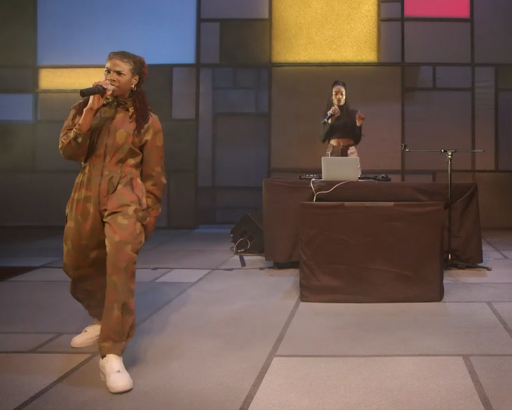 Haviah Mighty is seen on the left side of the GCTC stage with a DJ behind them