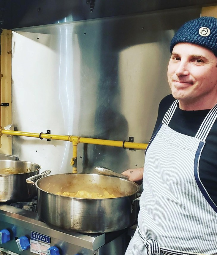Simon Bell is seen next to a big pot of soup in the kitchen at the Parkdale Food Centre