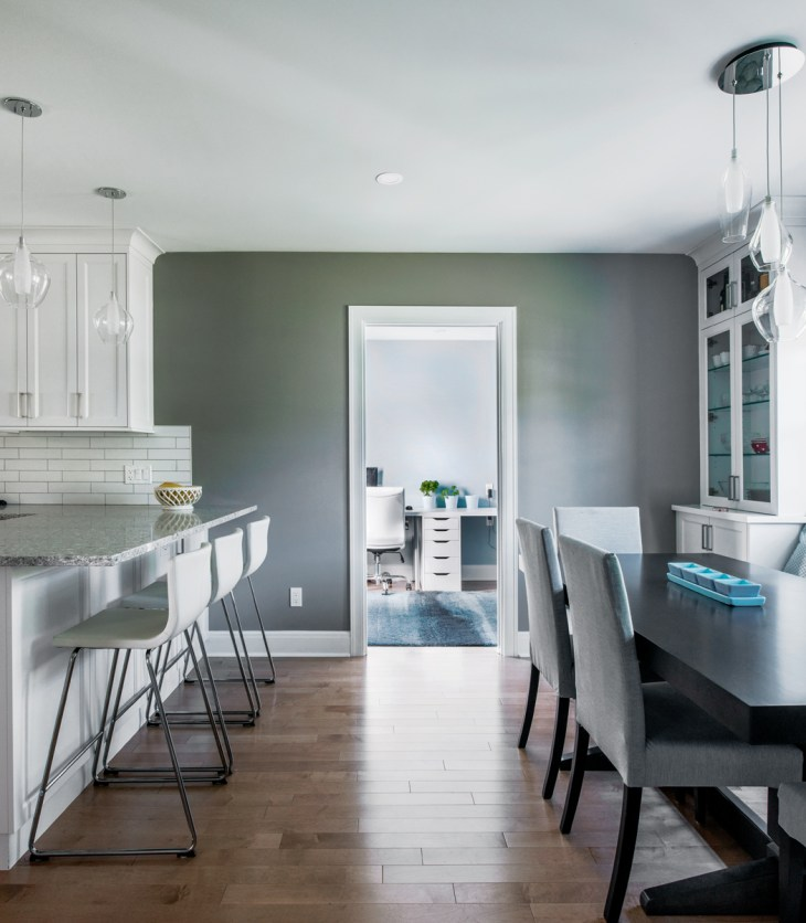 A renovated kitchen and dining room is seen in a staged home photo in a Westboro house