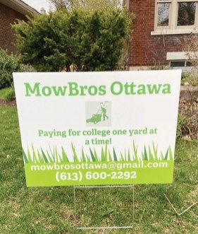 """A green and white sign on a lawn that reads """"MowBrows Ottawa, paying for college one yard at a time"""""""