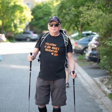 Michael Baine is seen walking outside with walking sticks