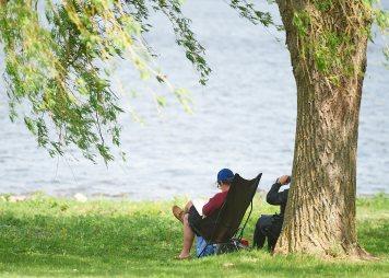 Locals enjoy some time riverside in May. Photo by Ellen Bond.