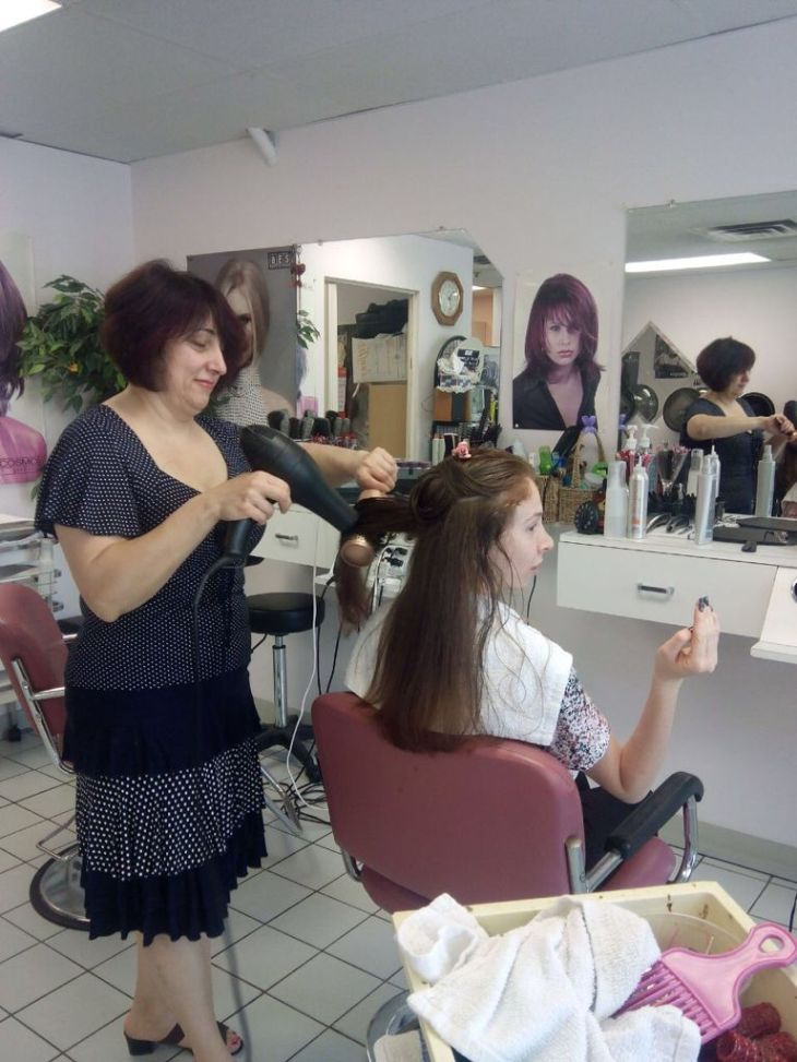 Stella Mail does the hair of a young woman at a hair salon