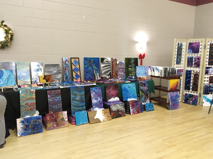 A row of paintings at the Churchill Seniors Centre.