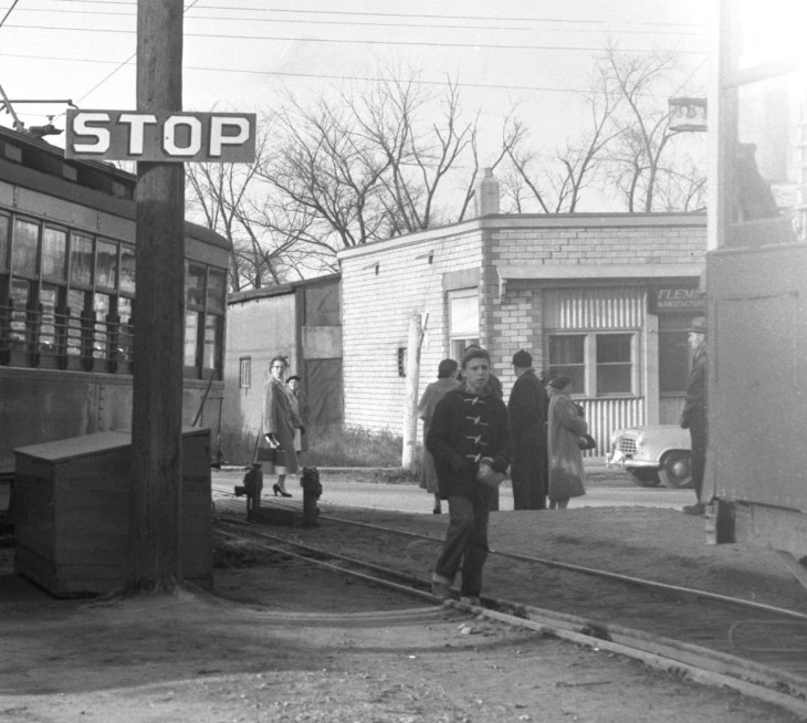 A black and white photo from the mid-1950s shows Laundry Land as a white brick building with pedestrians out front
