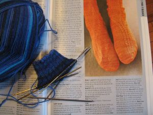 My new project: pattern, yarn, and sock cuff. Traveler's socks pattern by Stefanie Bold, in Interweave Knits Fall 2012