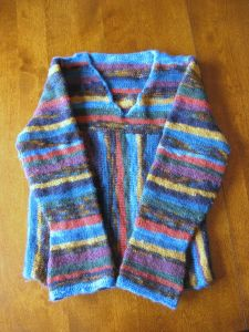 The first time I made this pattern, I used different yarns to make the stripes, and I knit the sleeves to match.