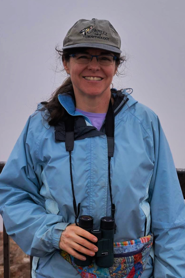 Kit Dunsmore with binoculars and Lab of Ornithology hat, ready to bird. Photo by Kurt Fristrup