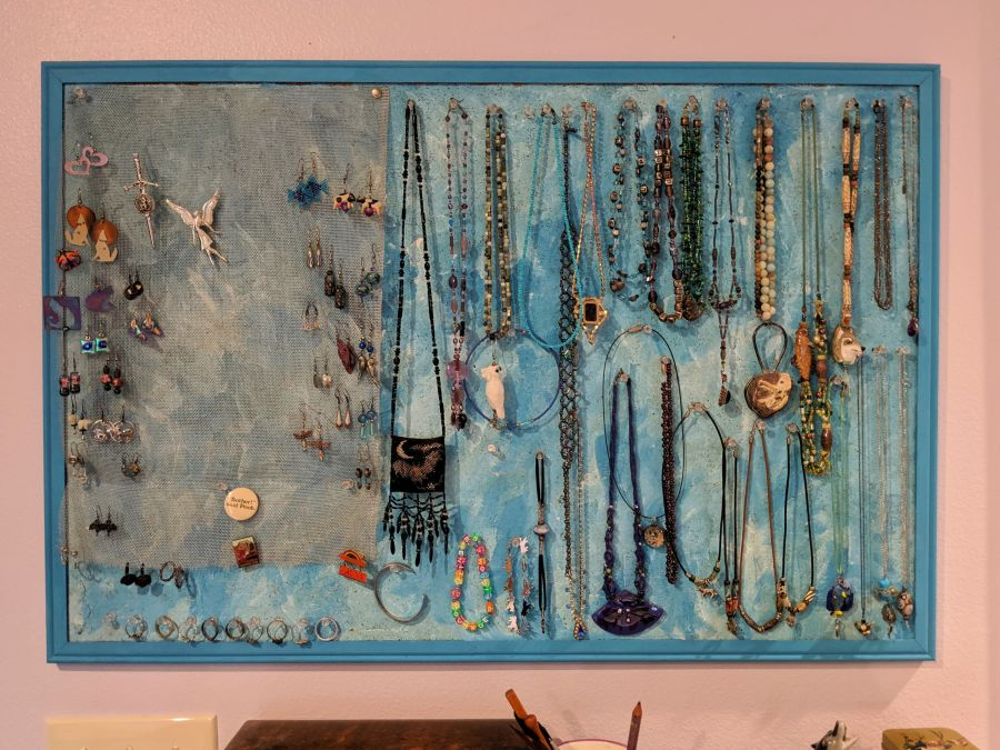 Corkboard turned into a DIY jewelry storage/display unit. Photo and board by Kit Dunsmore