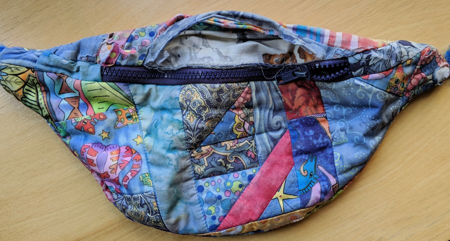 Crazy quilted fanny pack, faded and torn. Photo by Kit Dunsmore