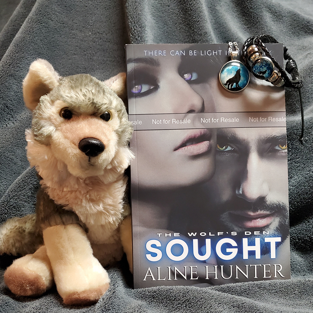 a signed print copy of Sought, a key ring, necklace, and book marks