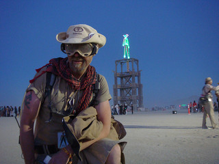 A Ranger in khaki front of the effigy as night falls.