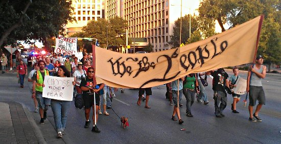 We the People Banner on an Occupy Austin march down Cesar Chavez