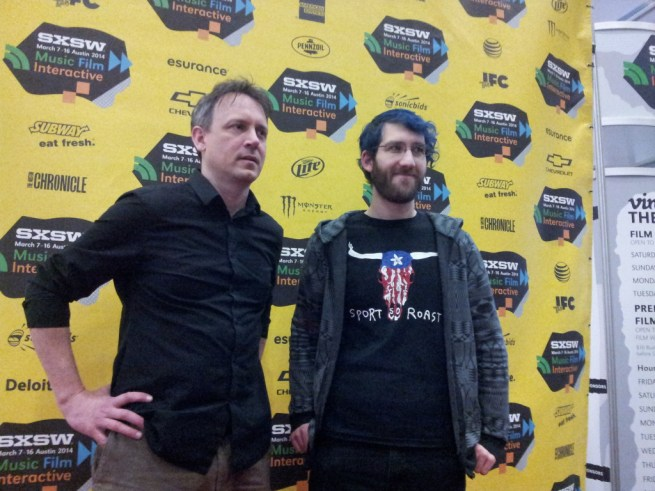 """In this March 7, 2014 photograph, Brian Knappenberger (left), director of """"The Internet's Own Boy,"""" poses on the Red Carpet with Noah Swartz, Aaron Swartz's brother, at a SXSW film screening. (Kit O'Connell)"""