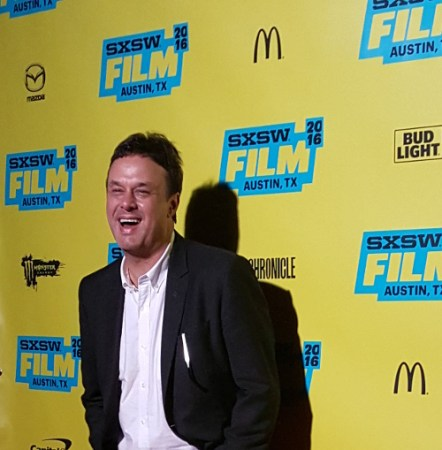 "In this March 15, 2016 photograph, John Scott Shepherd laughs and smiles during the red carpet at the SXSW premiere of ""You Me Her."" (Kit O'Connell)"