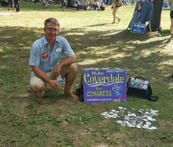 Mike Coverdale, an independent candidate for Congress poses with a small display promoting his candidacy outside the Wells Fargo Center in Philadelphia during the Democratic National Convention. July 27, 2016. (Kit O'Connell)