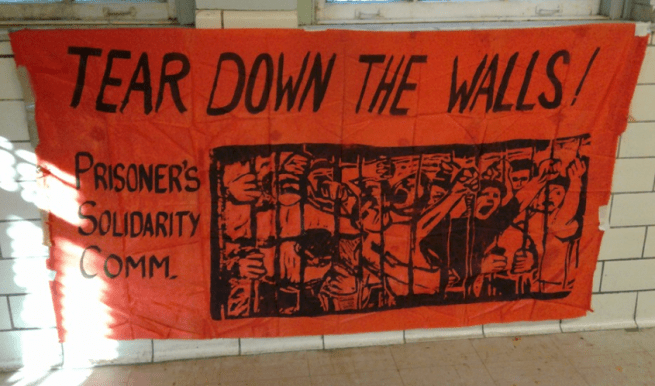 "Atlanta Georgia: A banner in solidarity with the National Prison Strike reads ""Tear Down The Walls."" (It's Going Down)"