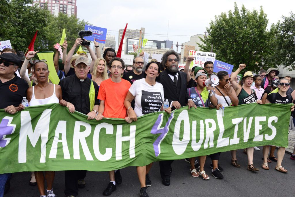 """Margaret Flowers (second from right) marches with Cornel West, Cheri Honkala and other activists during the """"March for Our Lives"""" in Philadelphia during the 2016 Democratic National Convention. July 25, 2016. (Flickr / Stephen Melkisethian)"""