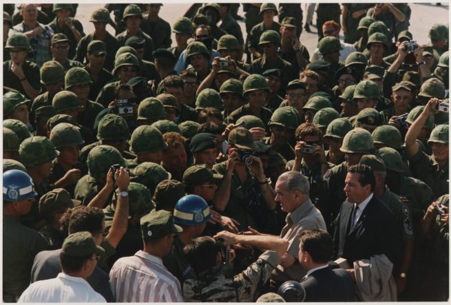 President Lyndon Johnson shakes hands with U.S. troops in Vietnam. December 23, 1967. (Wikimedia Commons / White House)
