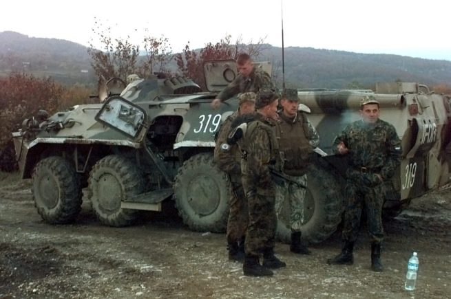 A group of Russian army soldiers stand near an armored vehicle during a peacekeeping mission in Bosnia-Herzegovina. November 1, 1996. (Wikimedia / Department of Defense / SPC Alejandro Cabello)