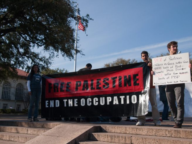 """File: Activists on the University of Texas at Austin campus hold a banner that reads """"Free Palestine. End The Occupation."""" (Flickr / Mishal A)"""