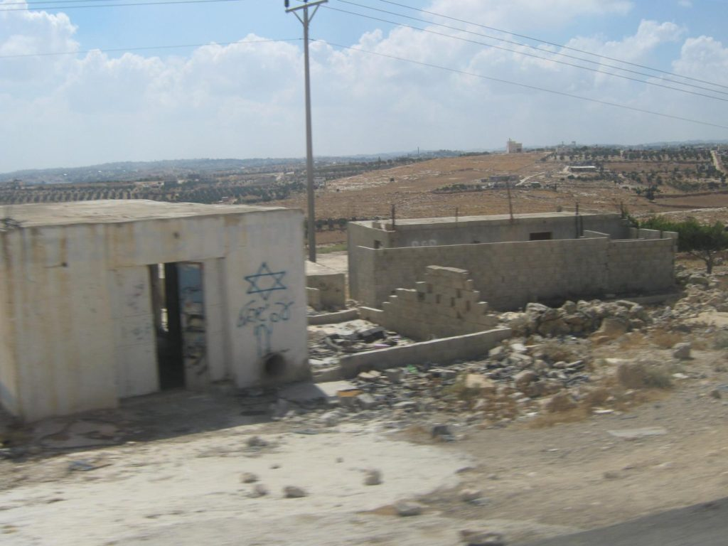 A new illegal settlement under construction in the West Bank. July 5, 2009. (Flickr / Neal Ungerleider)