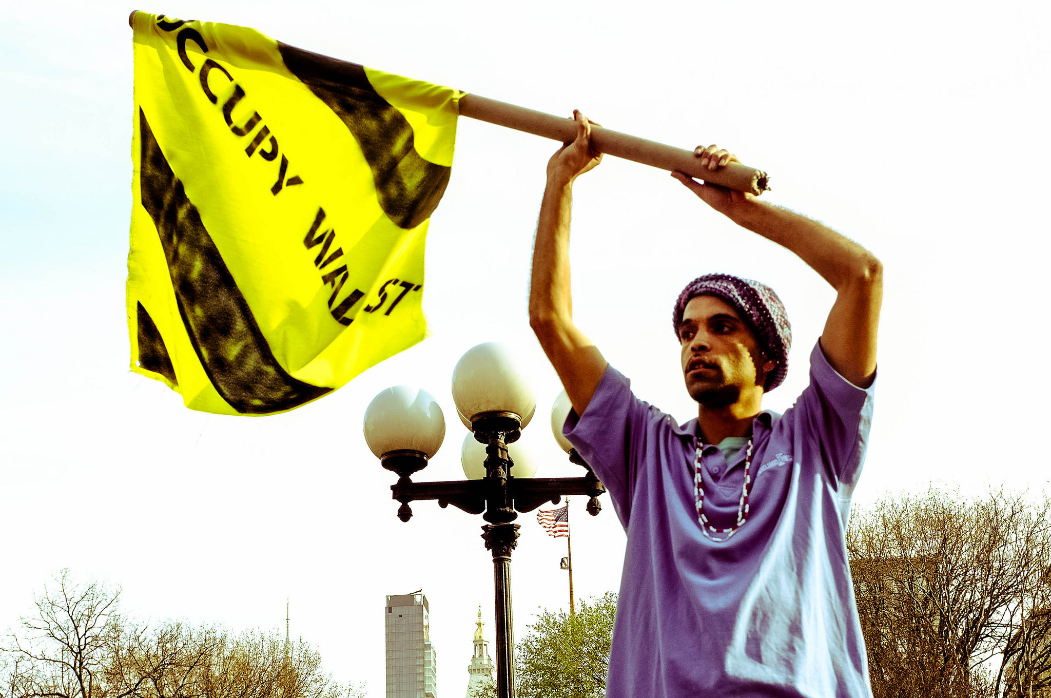 An activist waves a yellow and black Occupy Wall Street flag in New York City on March 23, 2012.