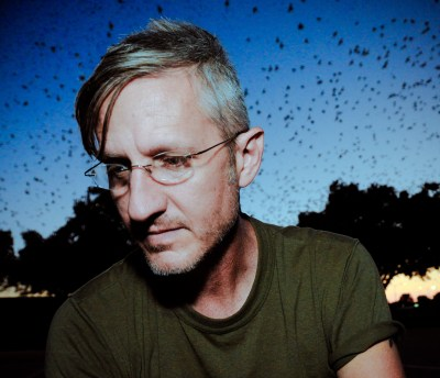 scott crow photographed at dusk as Austin's famous bats fill the sky. According to crow, building power is just as important as self defense.