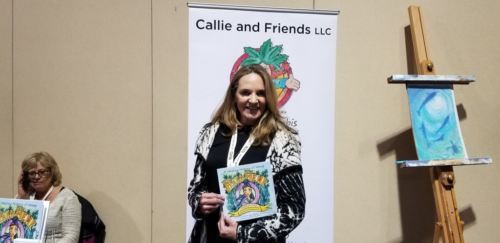 Kris Morwood poses with one of her cannabis parenting guides.