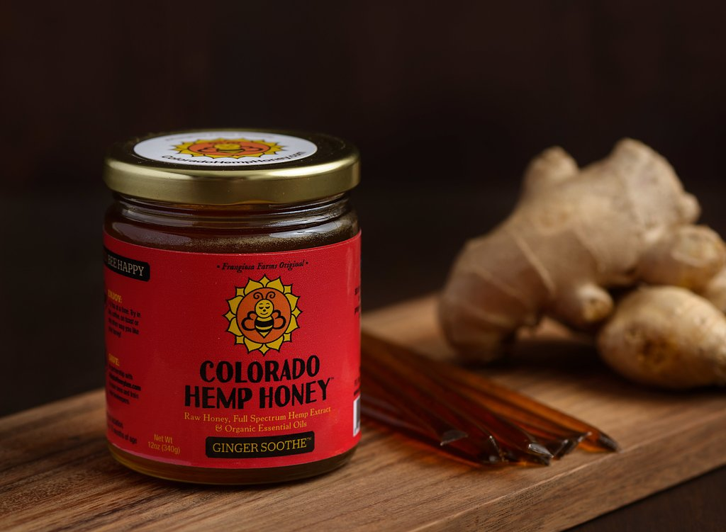 Colorado Hemp Honey with a piece of raw ginger