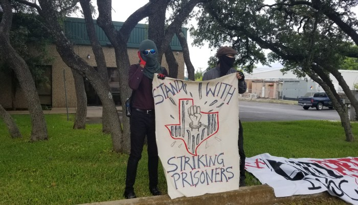 Anarchists gathered for the Juneteenth prison protest on June 18, targeting the Texas Correctional Industries showroom and another prison office.