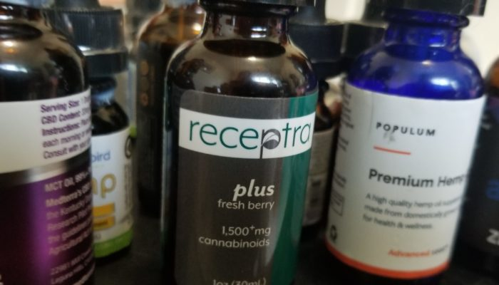 A collection of top CBD oil tincture bottles including Medterra, Receptra, Populum and Ananda Hemp. (Kit O'Connell)