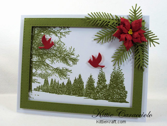 Come see how I made this snowy tree scene card embellished with a poinsettia and pine branches.