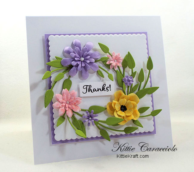 Come see how I made this pretty die cut paper flower wreath card.