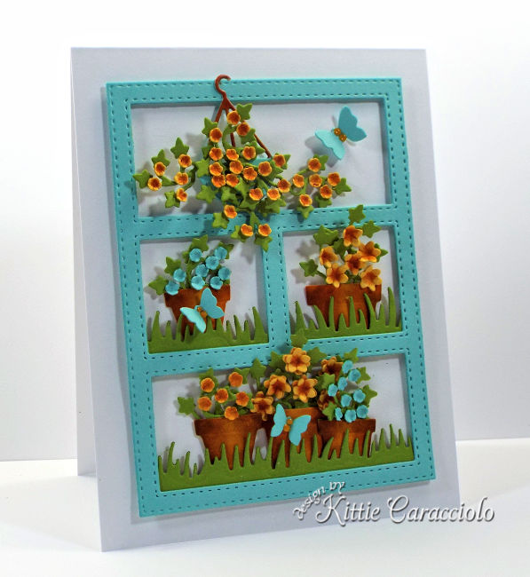Come see how I made this cheerful die cut paper flower pots and wreath card.