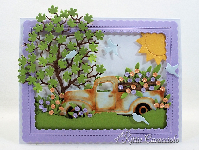 Come and see how I made this spring die cut truck and flower scene.