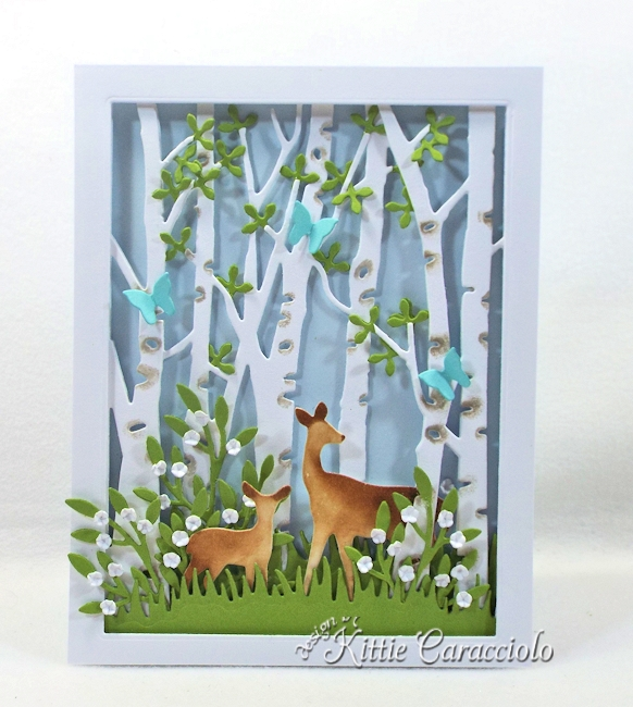 Come and see how I made this spring die cut birch tree scene.