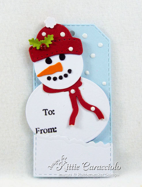 Come see how I made this cute snowman Christmas tag.
