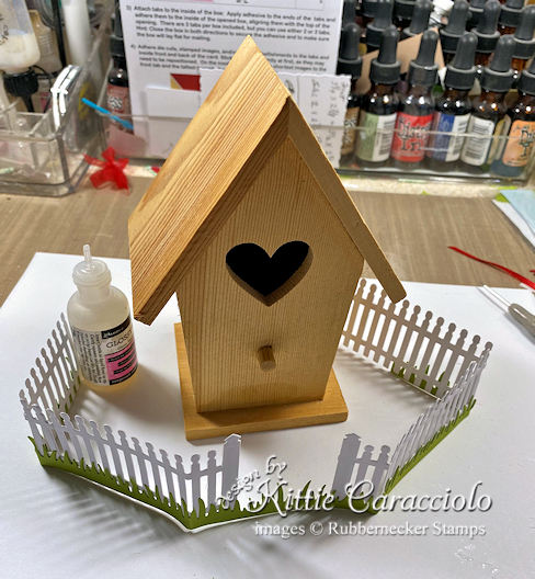 Click thru to see how I added a grass and fence layer to this decorative bird house.