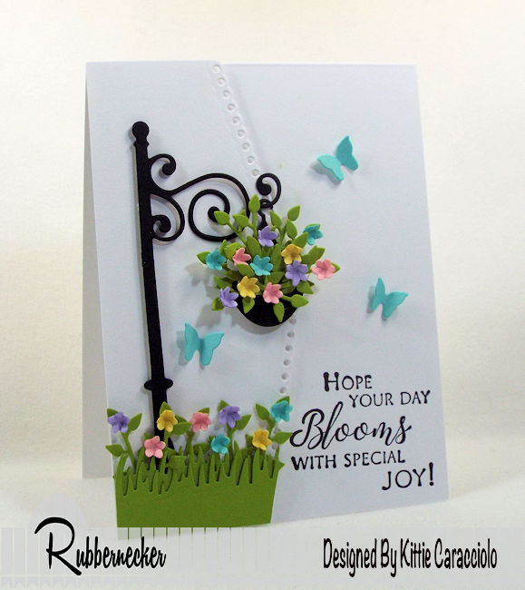 I love using spring flower blooms on my cards with an all white background that allows the colors to pop.  Click thru to see how I made this pretty scene.