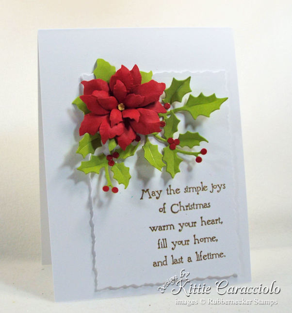 There is something so special about a bright red handmade paper poinsettia and holly on an all white card base. Click over to see how I made my poinsettia.