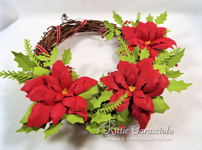 Come check out how I made this paper poinsettia wreath.