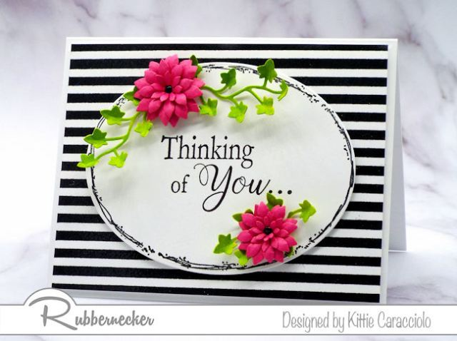 Create a classic card by framing the sentiment with flowers and foliage and layering it on a card base with a bold background.