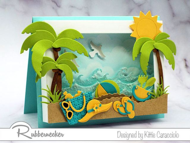 It was so fun to create this diorama shadow box frame beaach scene with the colorful beach accessoires and sparkling ocean waves.