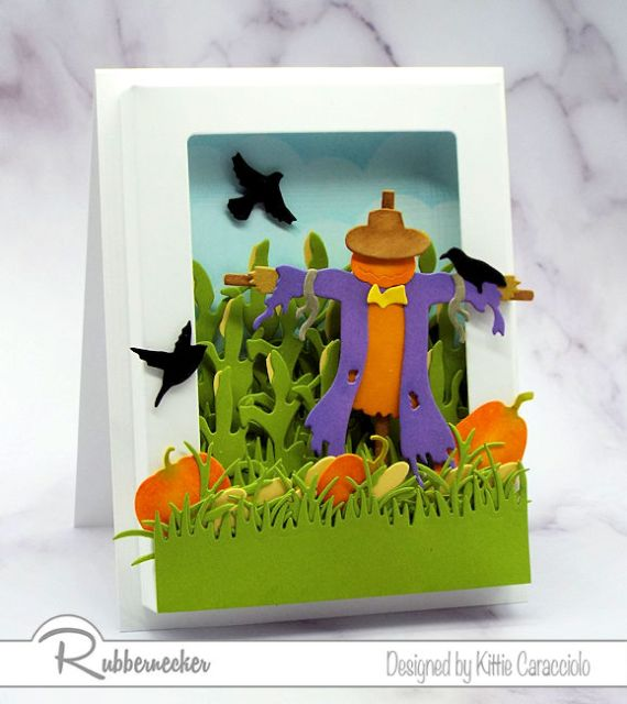 This Scarecrow Shadow Box Card featuring a fall scene in a shadow box was created entirely from die cuts
