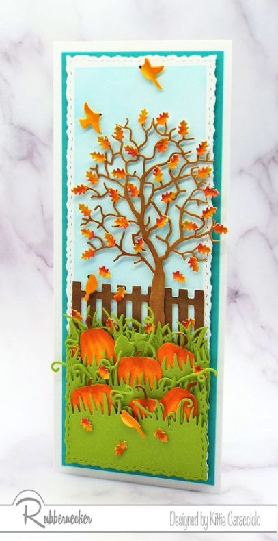 A vertical slimline fall card featuring a tall tree with shaped leaves and a pumpkin patch all created using die cuts