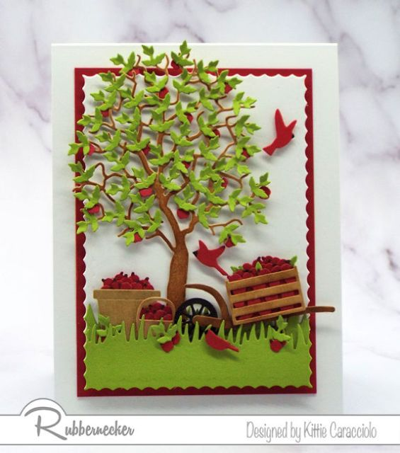 A handmade card featuring a leaf die cut used multiple times to create a full and colorful paper apple tree