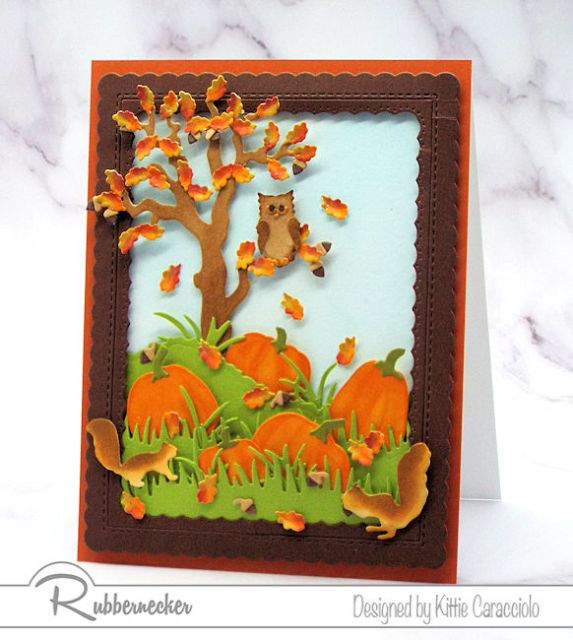 One of my fall cards featuring a die cut tree, pumpkins, squirrels and owl and tiny hand colored falling leaves