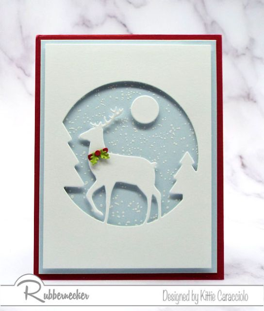A handmade card created using a die cut White Deer Silhouette against a handstamped snowy background to make a beautiful DIY greeting card